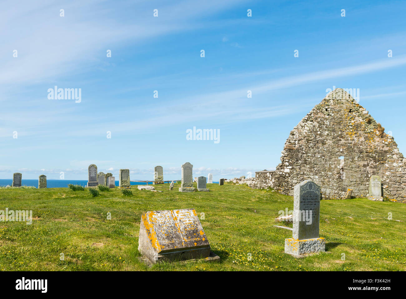 Graveyard on Trumpan with grave stones and old chapel on the Isle of Skye in Scotland. Stock Photo
