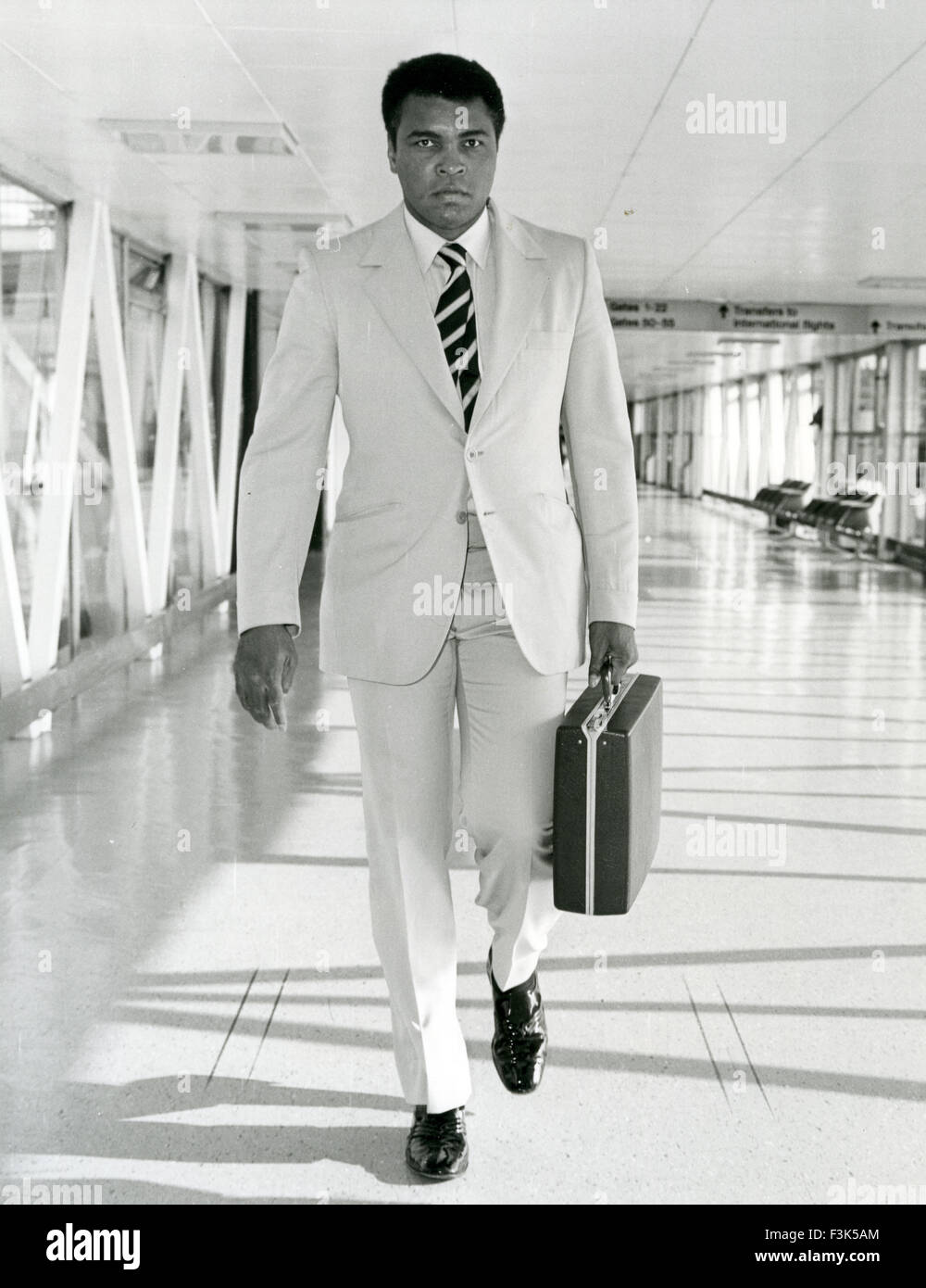 MUHAMMAD ALI  (Casius Clay) American boxer arriving at Heathrow airport about 1967 - Stock Image