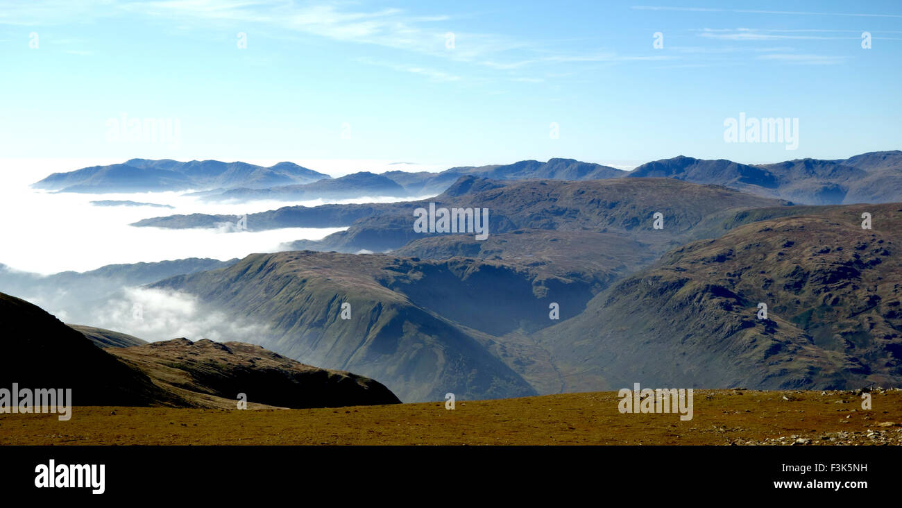 the tops of the Langdales  viewed from Helvellyn - Stock Image