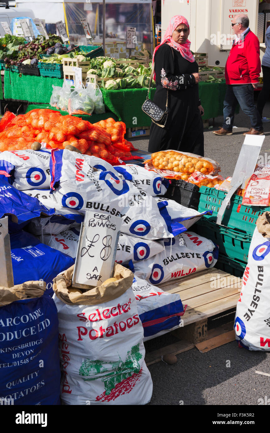 Sacks of potatoes and fruit and veg at open air market in Bristol, England - Stock Image