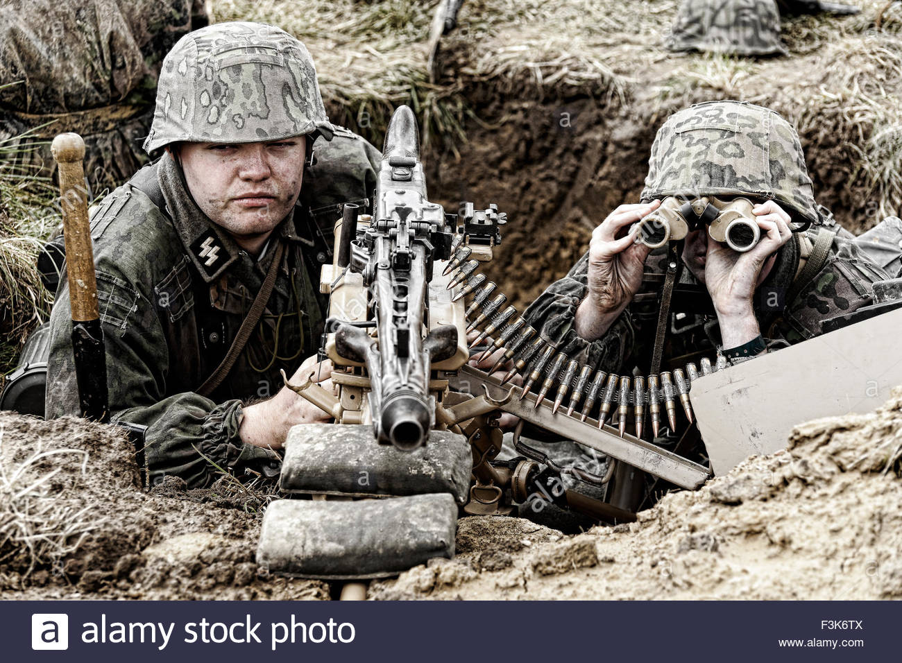 A re-enactor dressed as a German WW2 solider with a MG42 machinegun