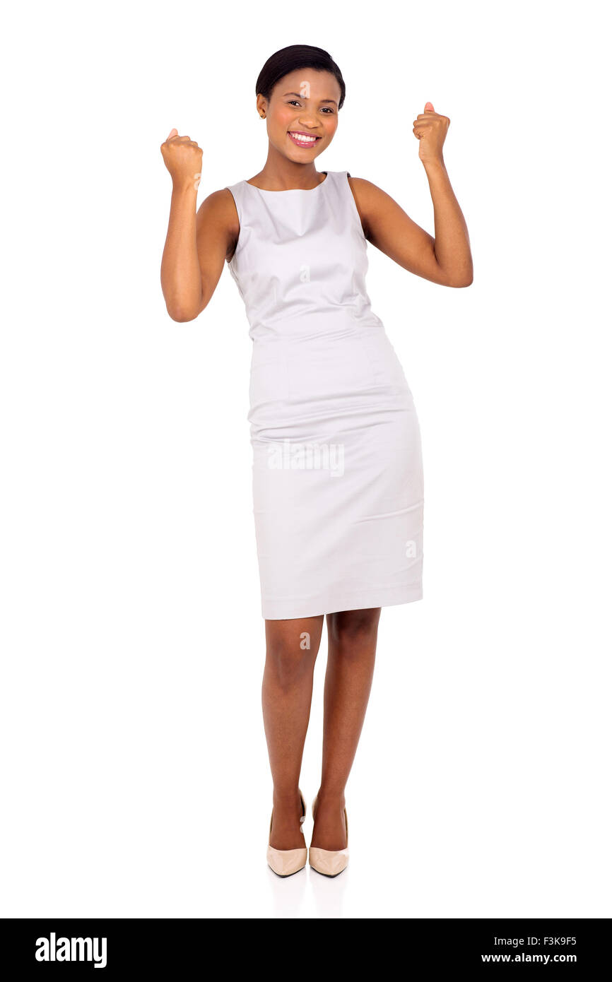 cheerful afro American business woman waving fists isolated on white background - Stock Image