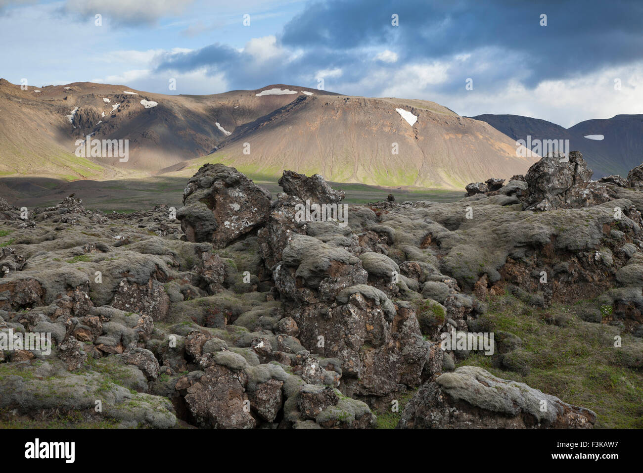 Moss-covered lava field and mountains near Hveragerdi, Sudherland, Iceland. - Stock Image