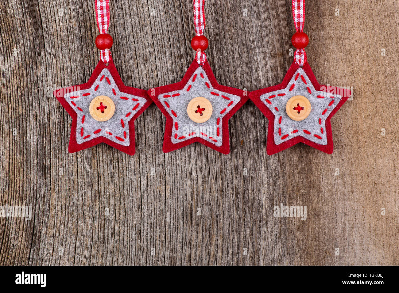 Red Fabric Star Merry Christmas Handmade Decoration Over Rustic Elm Wood Background