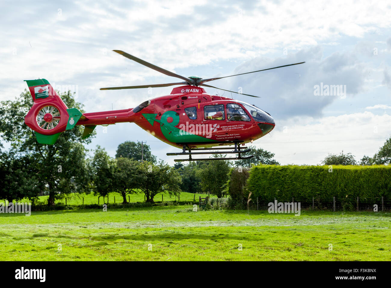 Wales air Ambulance on take off after attending emergency - Stock Image