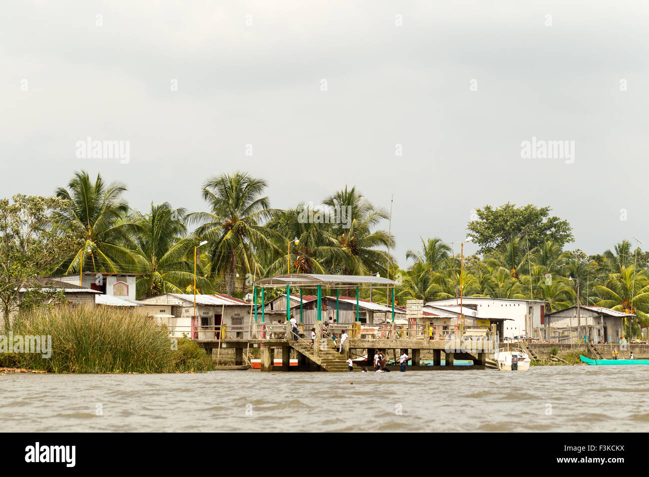 People Chilling Down On A Hot Summer Day In Ecuadorian Coast Village - Stock Image