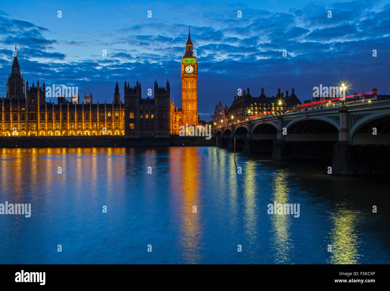 A view across the River Thames of the Houses of Parliament and Westminster Bridge in London. - Stock Image