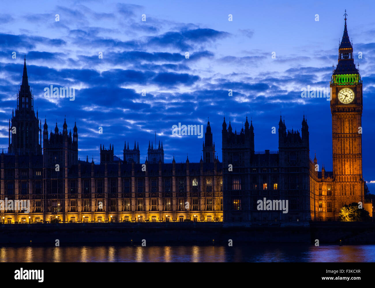 A view across the River Thames of the Houses of Parliament in London. - Stock Image