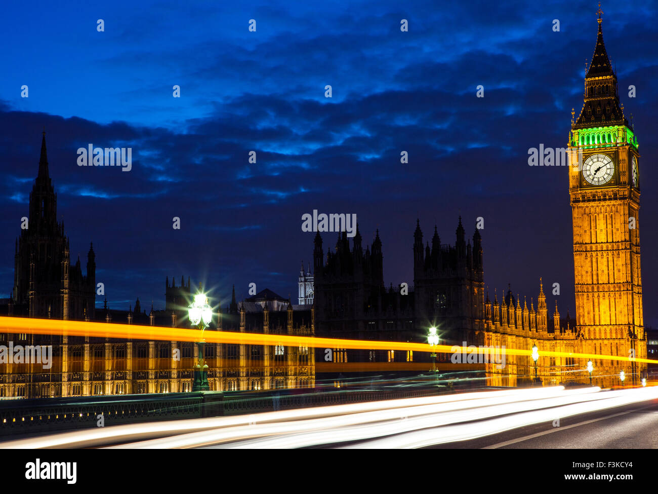 Light trails from London traffic passing by the Houses of Parliament on Westminster Bridge. Stock Photo
