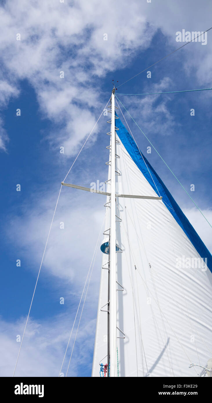 Main Sail on a sailboat filling with wind. - Stock Image