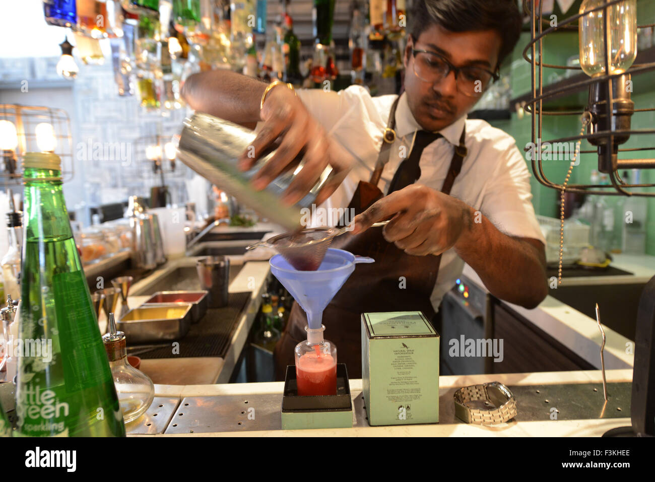 Mixing up cocktails at the Tippling Club cocktail bar in Singapore. - Stock Image