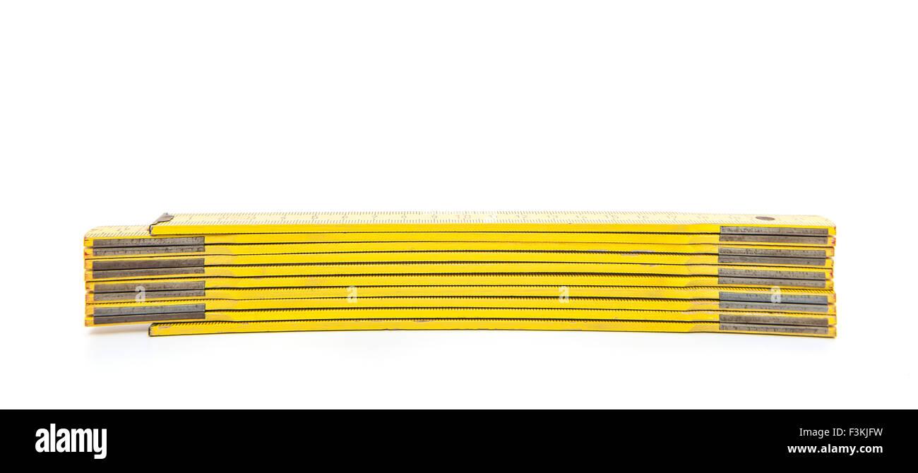 Standard folding meter stick. All on white background Stock Photo
