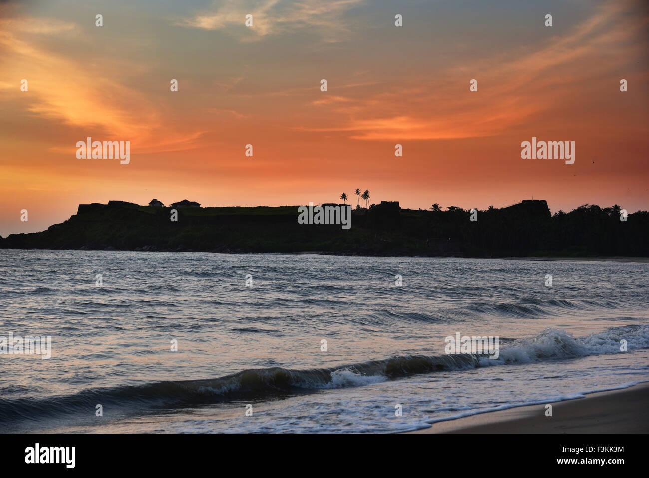 Sunset over ocean and beach in Kerala India.Bekal fort beach Kasargode Beach,cloud,flat,horizon,india,indian,kerala,ocean,reflec - Stock Image