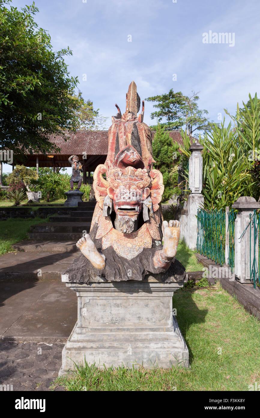 Painted statue at Tirta Gangga water palace, Bali, Indonesia - Stock Image