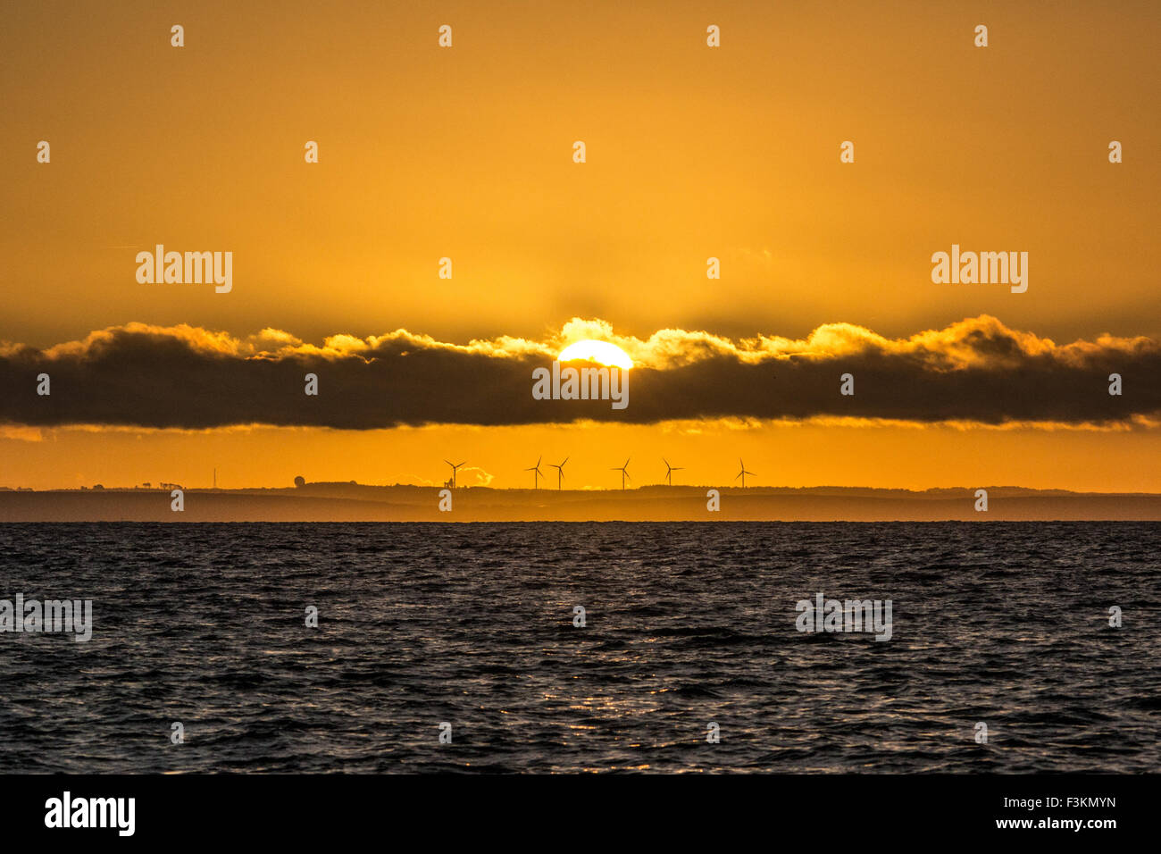 Mousehole, Cornwall, UK. 9th October 2015. UK Weather. The sun rises over Goonhilly, as viewed from Mousehole across - Stock Image