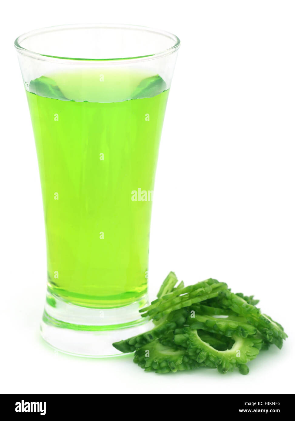 Herbal juice of green momodica over white background Stock Photo