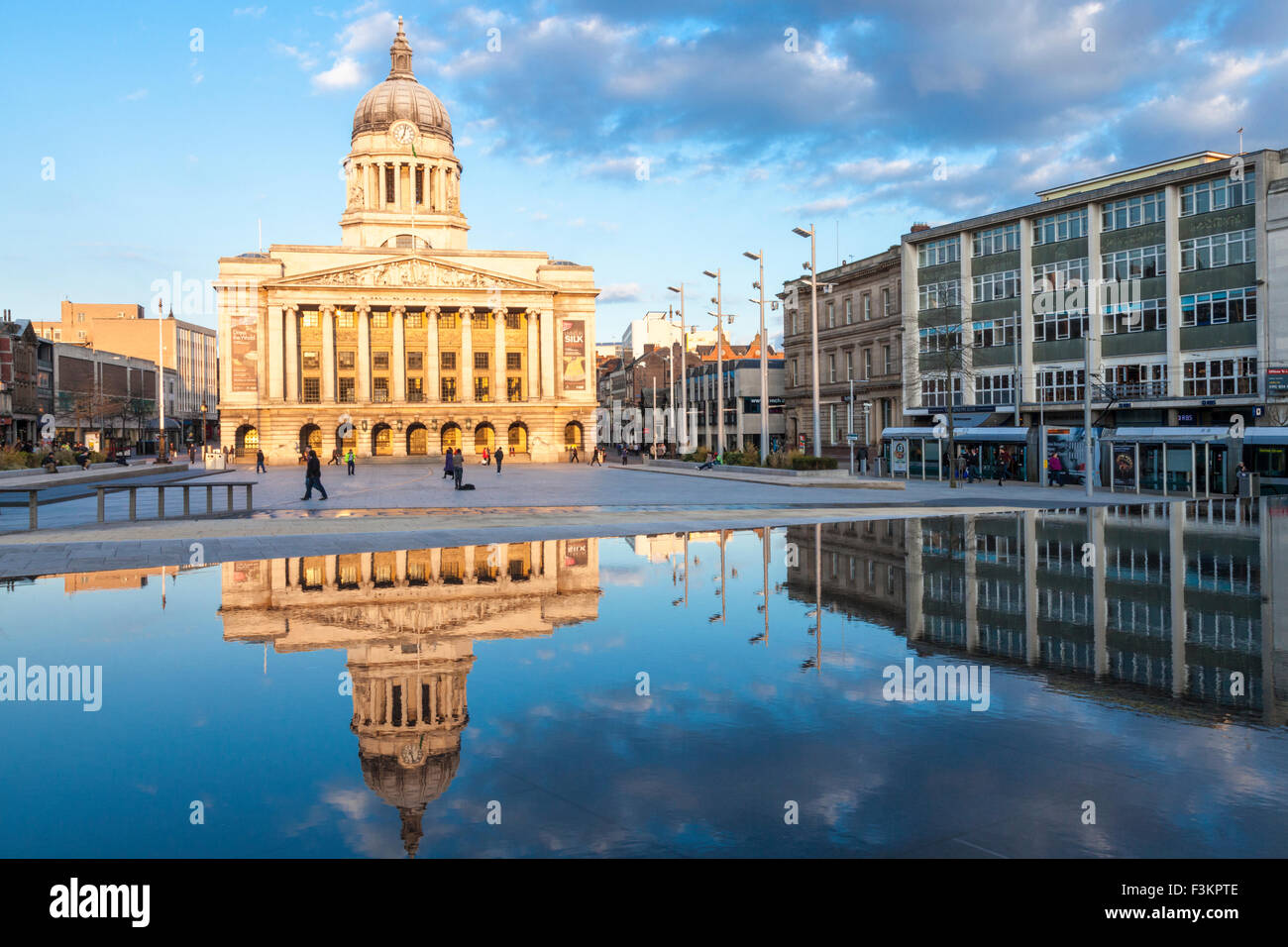Nottingham city centre. The Council House, Nottingham City Council, lit by evening sunlight in the Old Market Square, - Stock Image