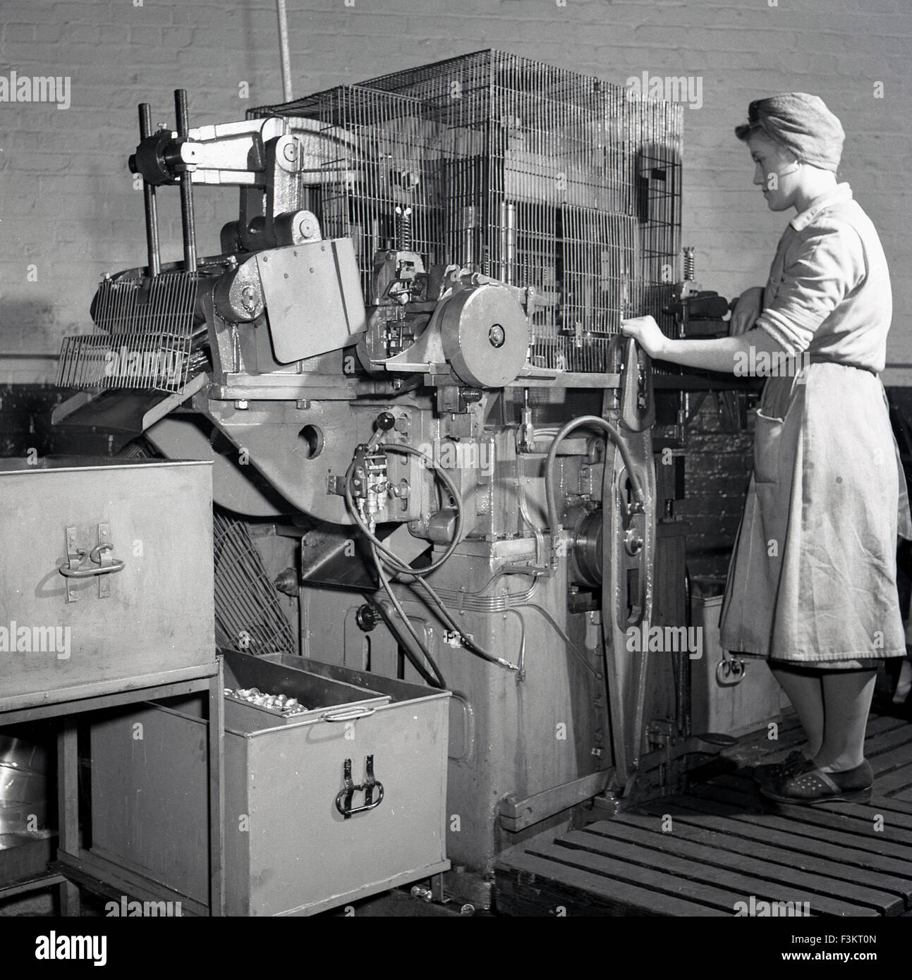 Ever Ready Battery Company Stock Photos Wiring Works Telford Historical 1950s Adult Female Operative Using A Large Machine At The British