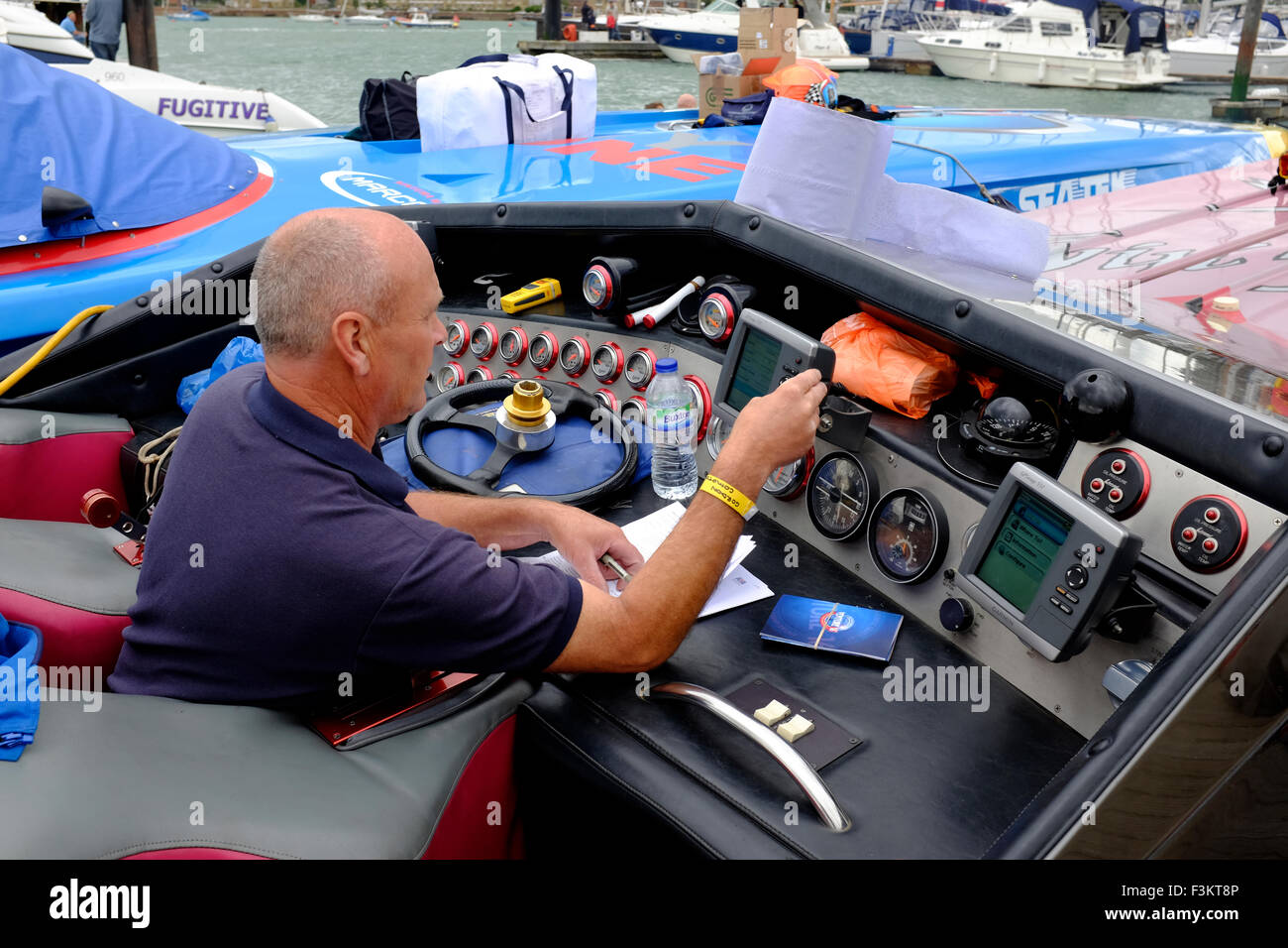 checking navigation systems The Yacht haven 2015, Cowes Classic, Power Boat Race, Cowes, Isle of Wight, England, - Stock Image