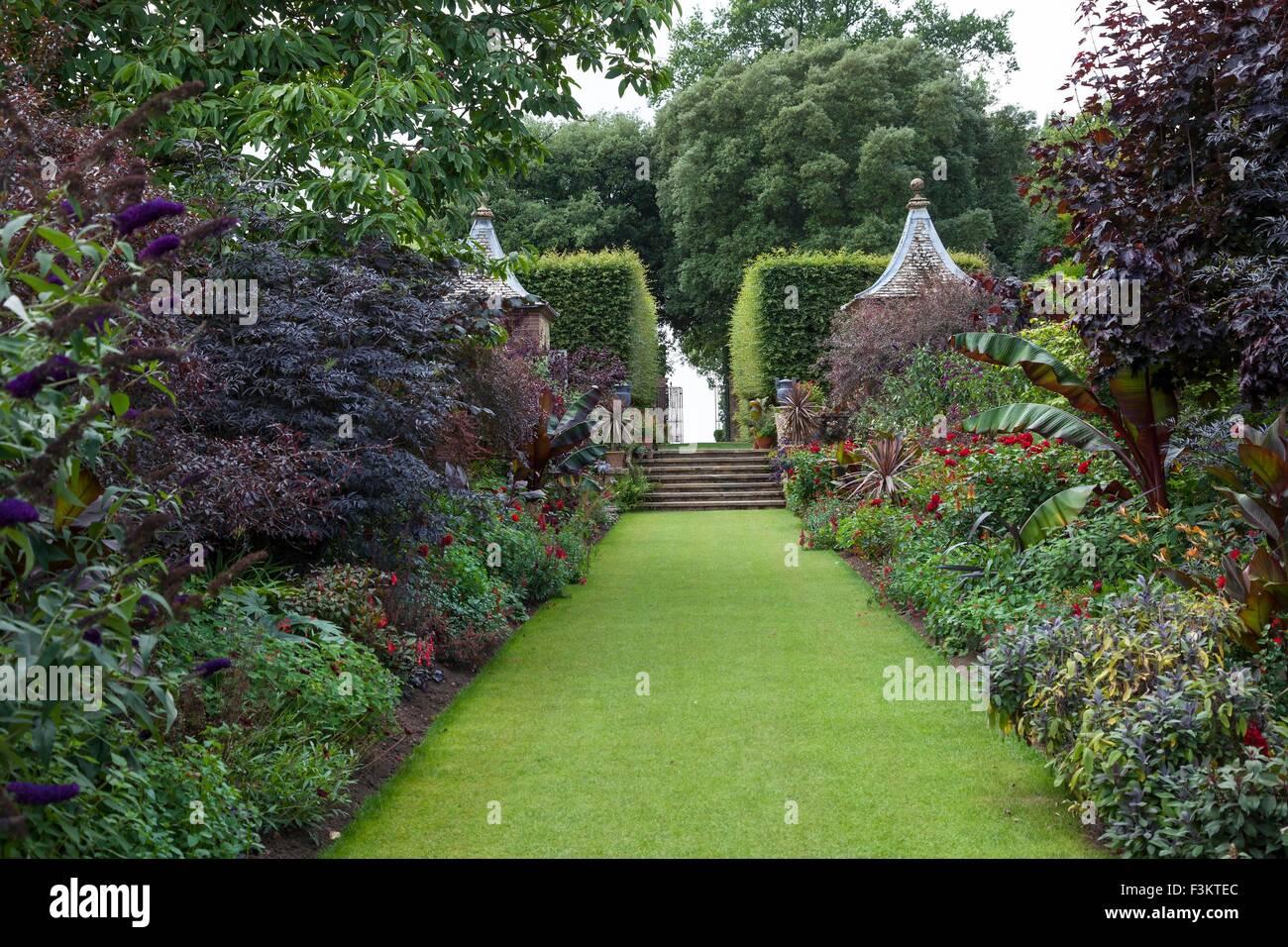 English garden borders with summerhouses. - Stock Image