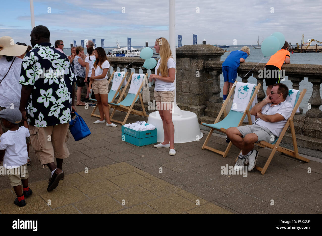 Cowes Week, 2015, Isle of Wight sales staff Liz Earle cosmetics The Parade Yacht Racing, Shore side entertainments, - Stock Image