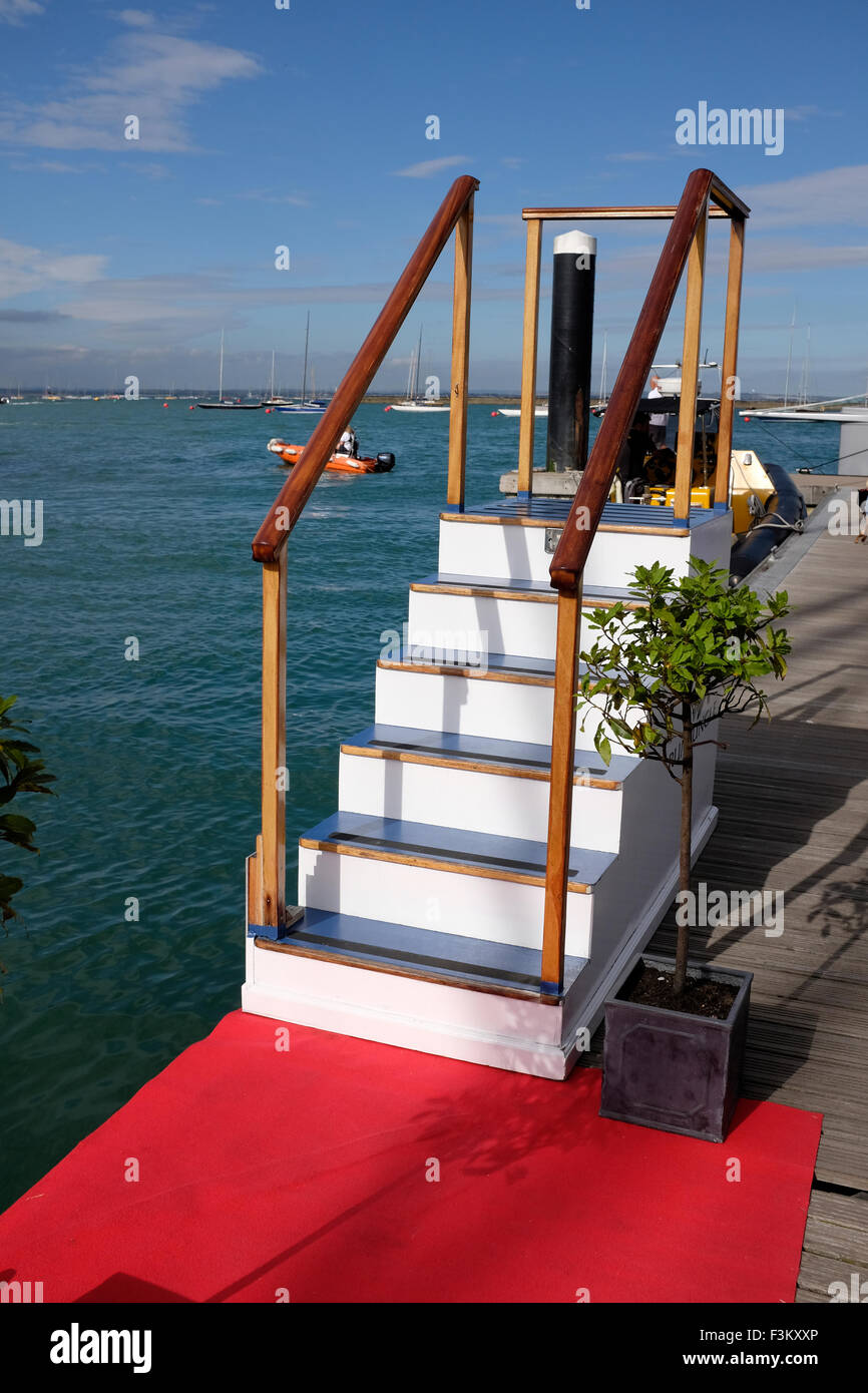 Cowes Week, 2015, Isle of Wight red carpet steps to no where on marina pontoon The Yacht Haven Yacht Racing, Shore - Stock Image