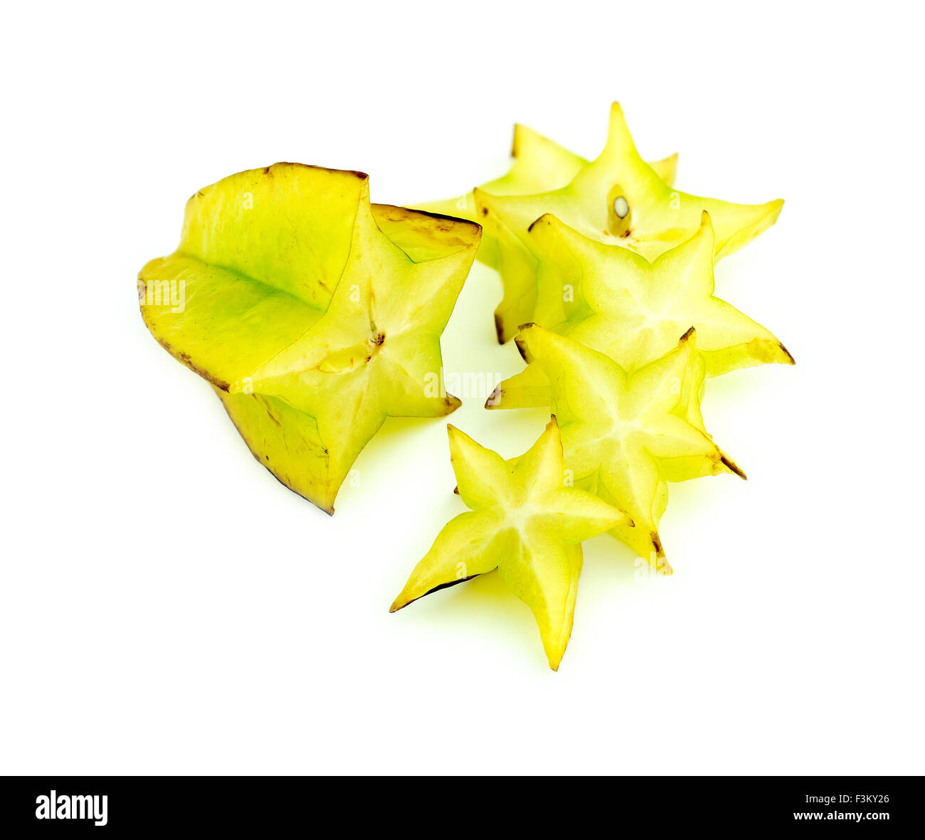 Beautiful setup of ripe vibrant starfruit slices isolated on white - Stock Image