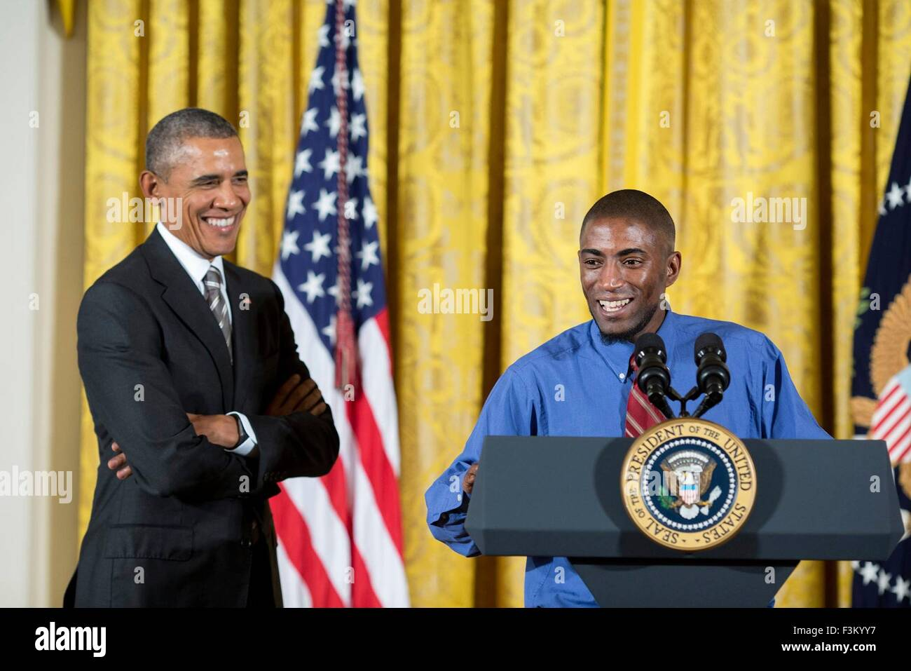 Washington DC, USA. 7th October, 2015. U.S. President Barack Obama smiles as Terrence Wise of Fight for $15 introduces - Stock Image