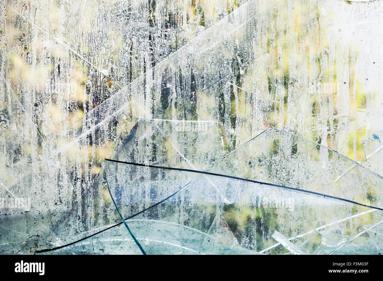 Dirty broken glass fragments, grungy background photo texture - Stock Image