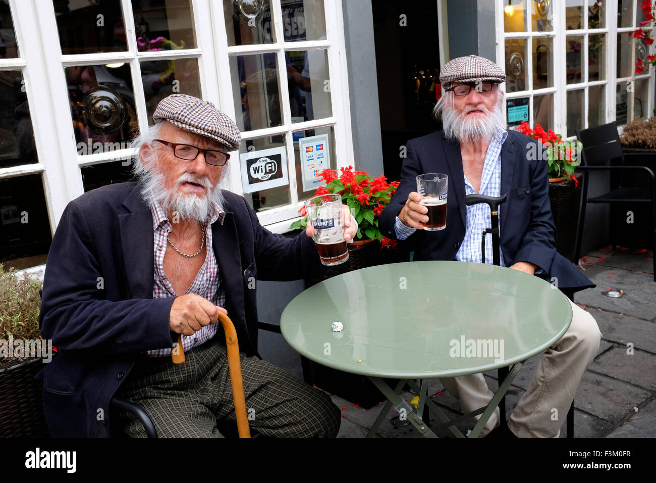 to elderly gentlemen drinking out side The Vectis Pub Yacht Racing, Shore side entertainments, Bands, Yacht Club - Stock Image