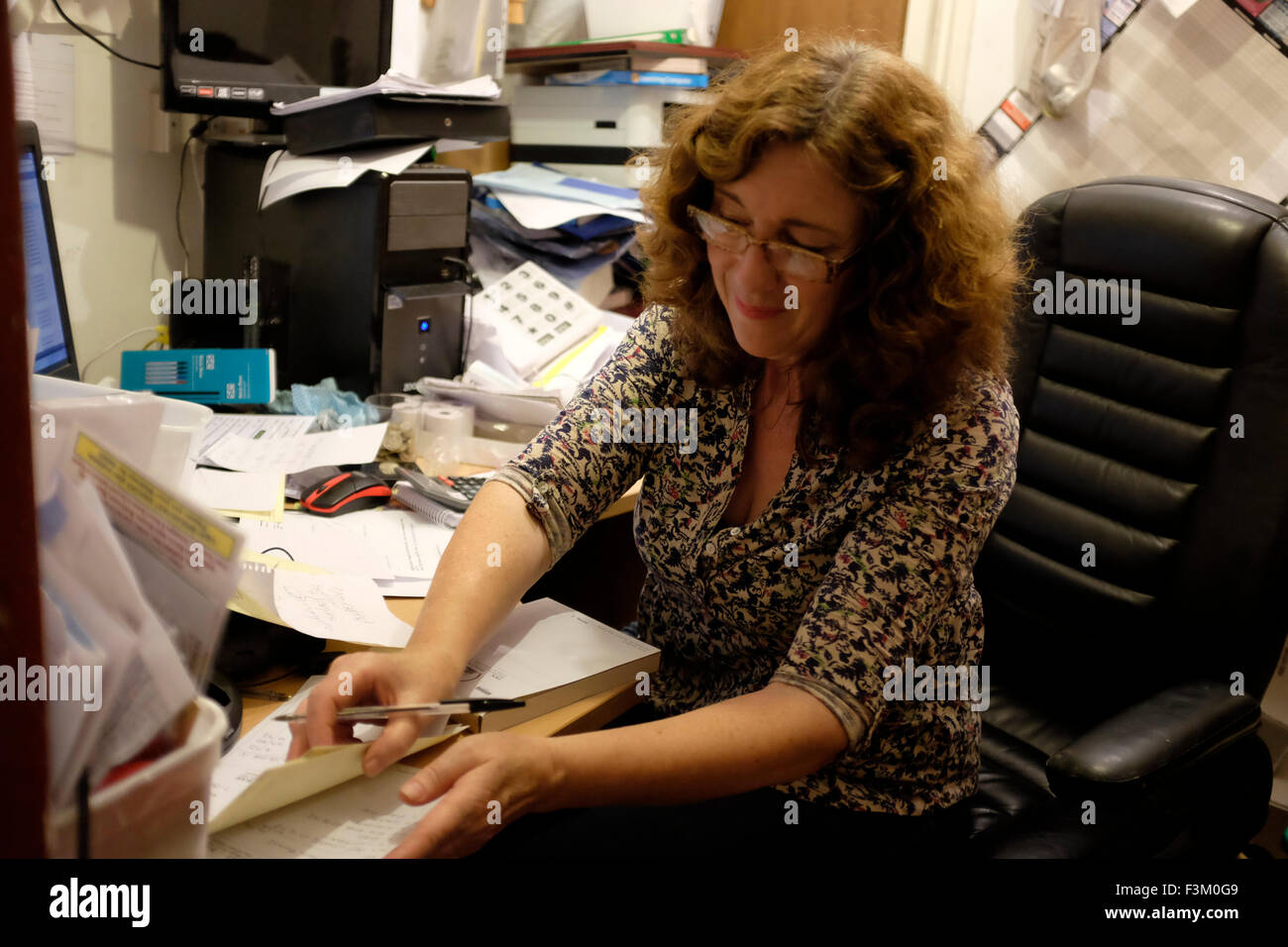 Sally Cass landlady in office The Duke of York Pub customers beer drinking band Yacht Racing, Shore side entertainments, - Stock Image