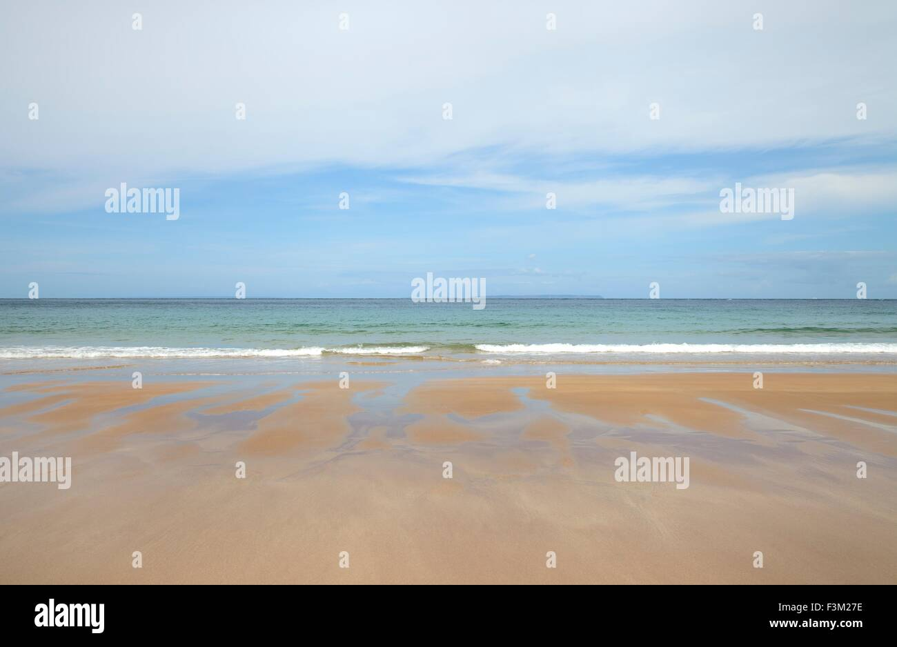 A calm, relaxing beach background with muted colours. - Stock Image