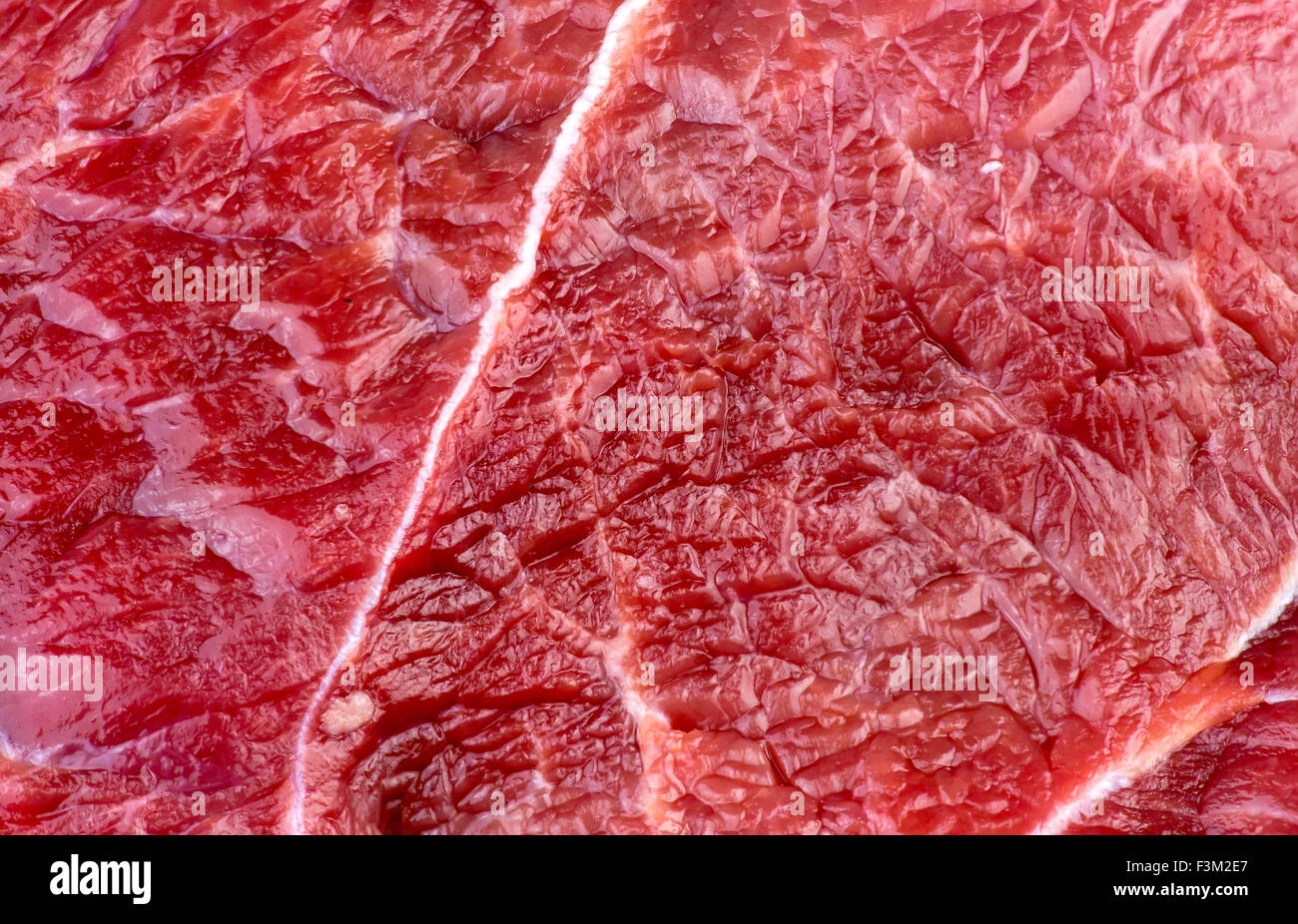 Closeup macro background texture of red beef lamb meat - Stock Image