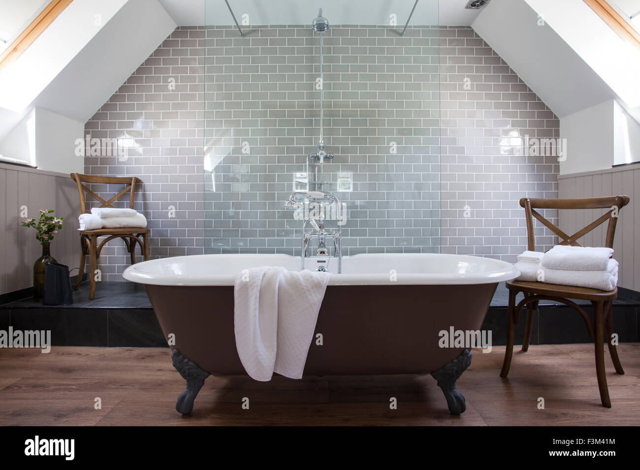 Roll top bath with ball and claw feet in luxury bathroom - Stock Image