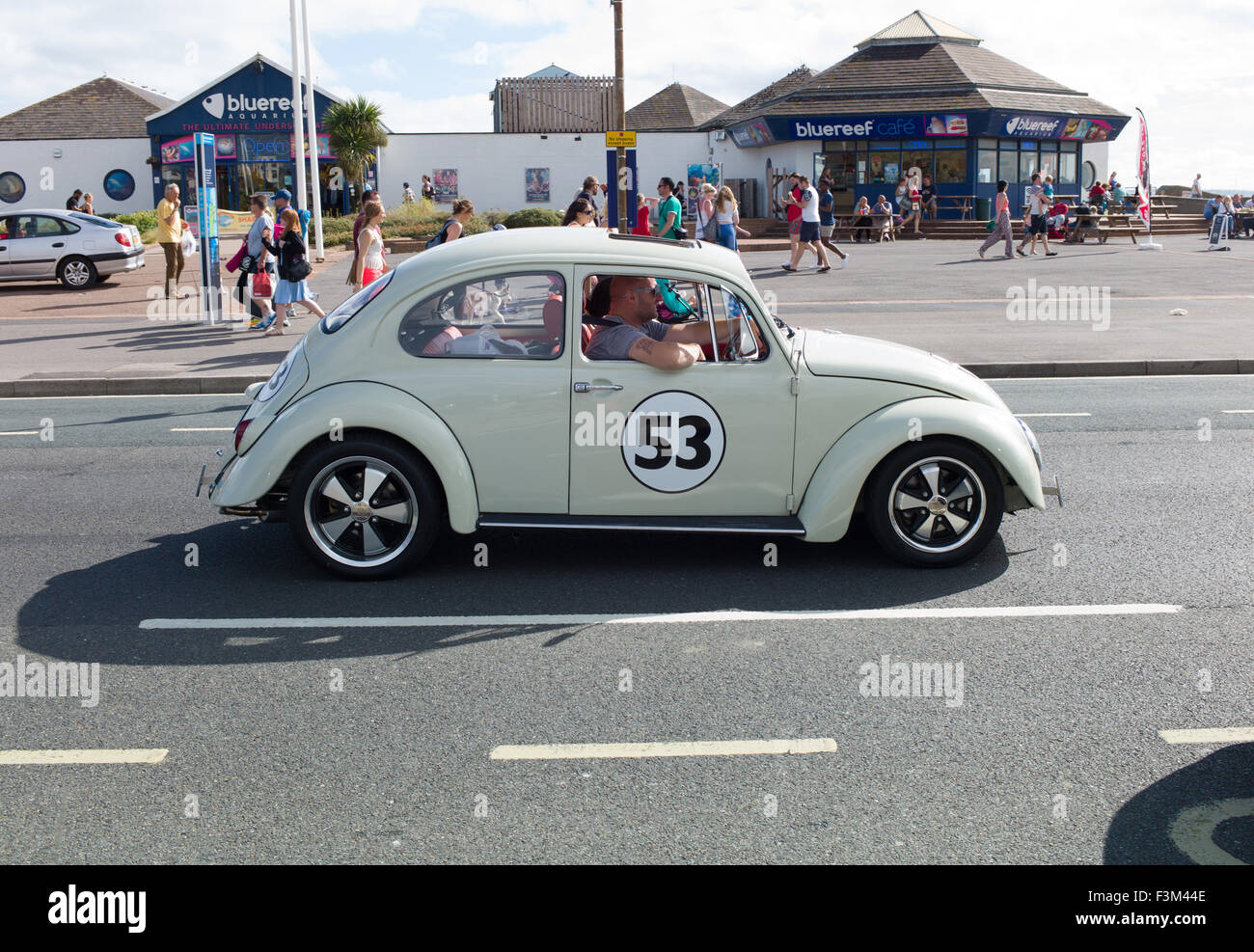 VW Herbie Beetle driving along Southsea seafront Portsmouth - Stock Image