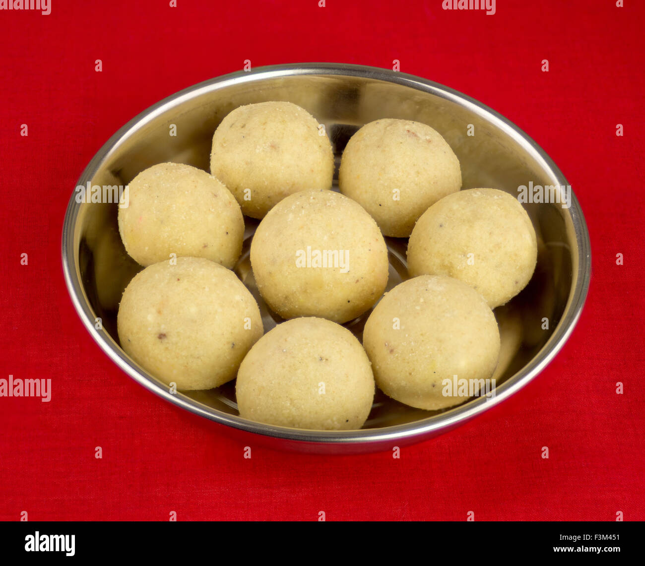 Indian Laddoo Laddu Sweets Served On Silver Plate Sitting On A Red Stock Photo Alamy