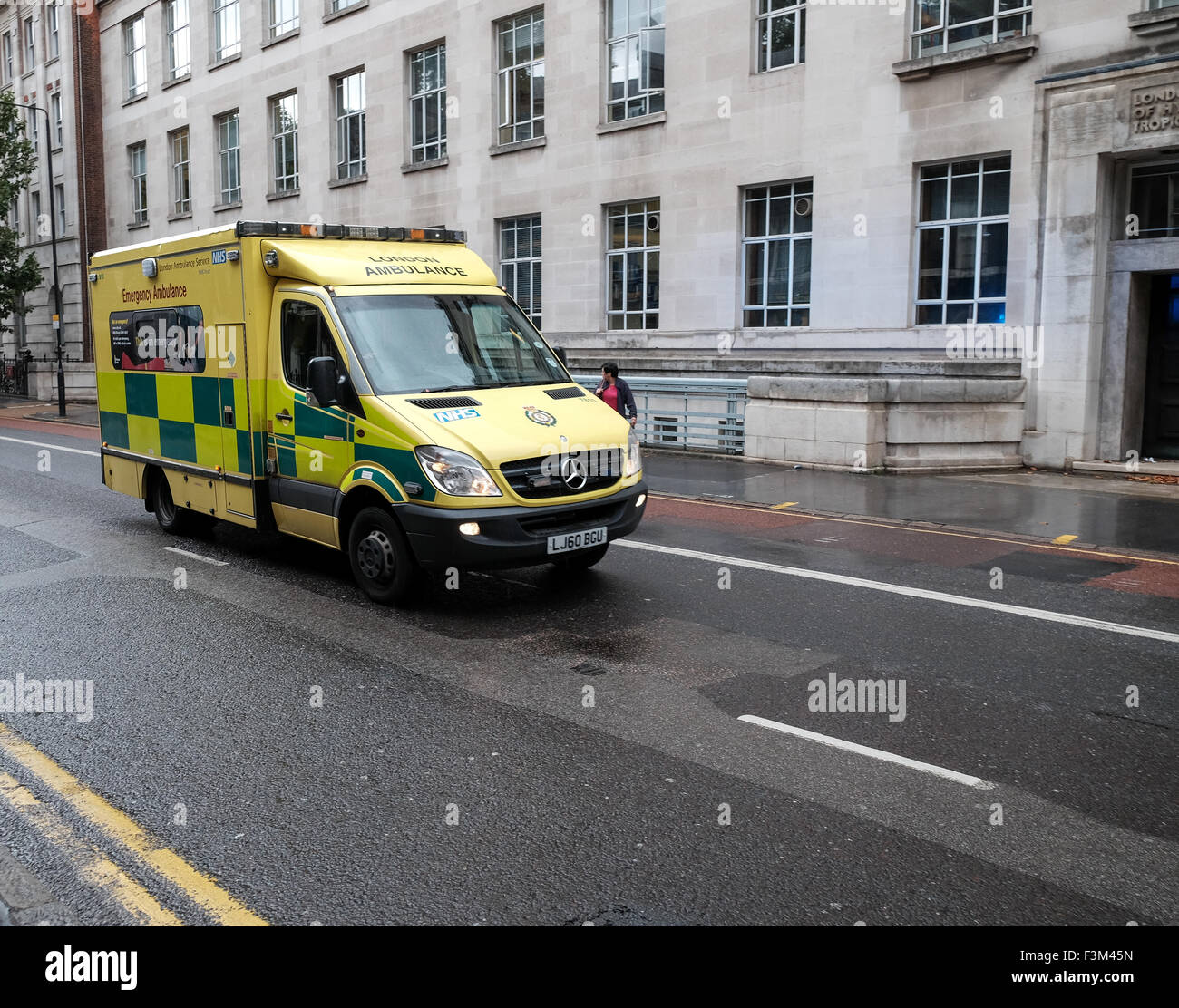 London ambulance services on an emergency call past London school of Hygiene and tropical medicine - Stock Image