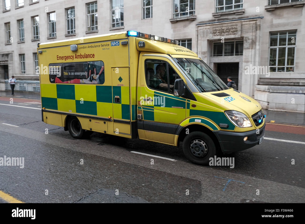 London ambulance services on an emergency call past London school of Hygiene and tropical medicine Stock Photo