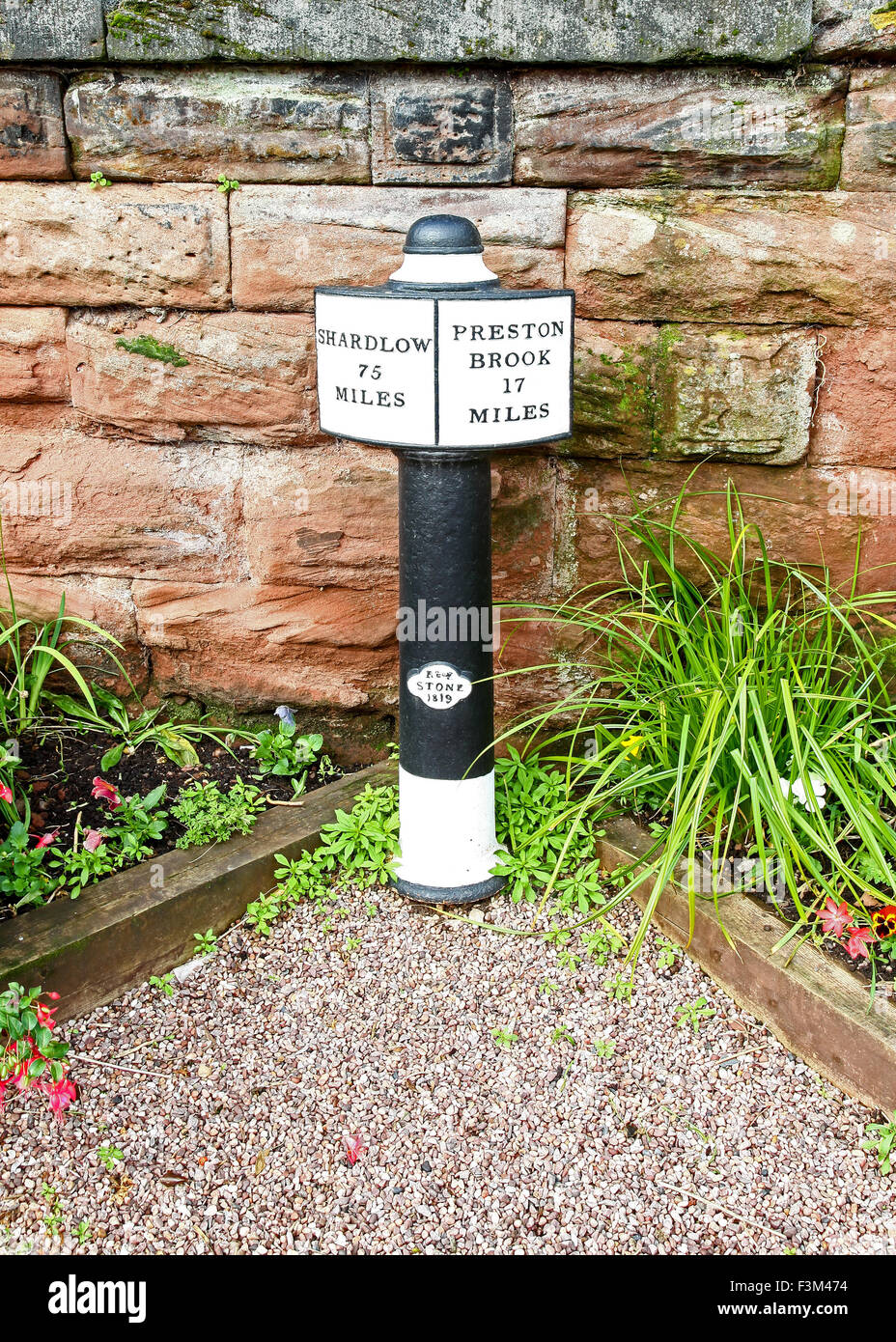 A sign post saying Shardlow 75 miles and Preston Brook 17 miles on the Trent and Mersey Canal Middlewich Cheshire - Stock Image