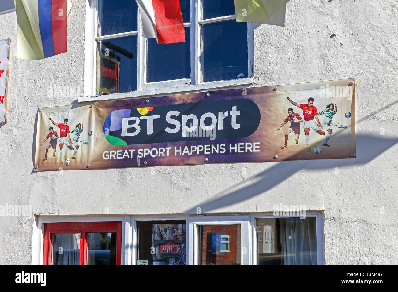 A sign on a pub or public house saying bt sport shown here - Stock Image