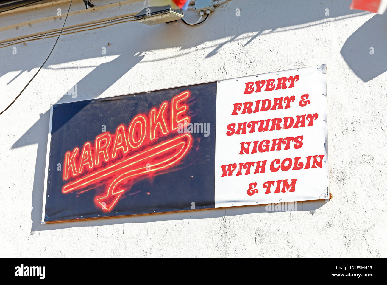 A sign on a pub or public house saying karaoke every Friday and Saturday night - Stock Image