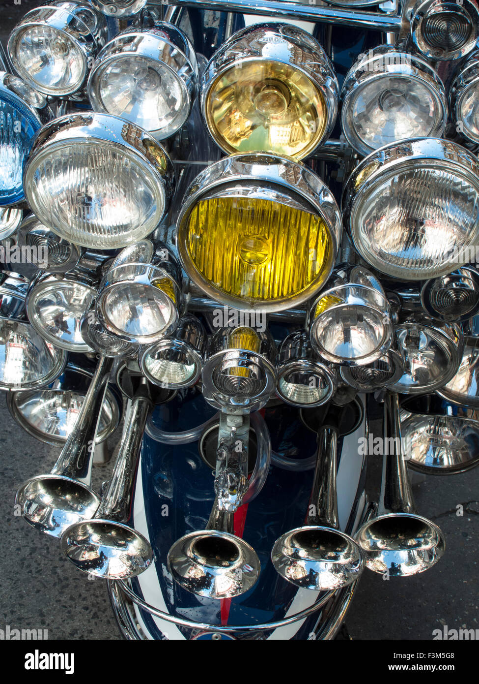 Customised scooter from the 1960's, Mod's Lambretta with lamps, mirrors and badges - Stock Image