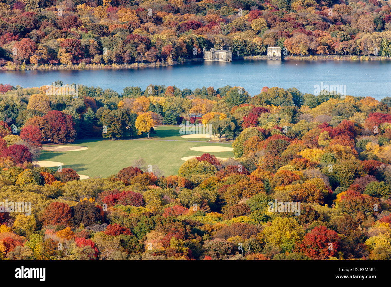 Aerial view of the Great Lawn and Jacqueline Kennedy Onassis Reservoir in Central Park with autumn foliage colors. - Stock Image
