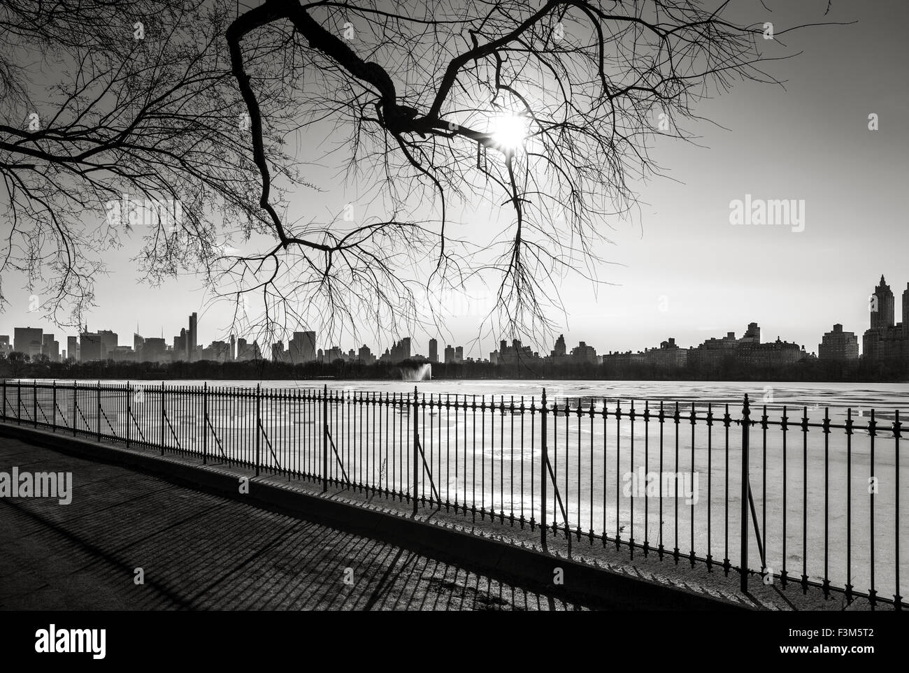 Black and White photograph of New York in winter, The Reservoir in Central Park and Upper West Side, NYC. Stock Photo