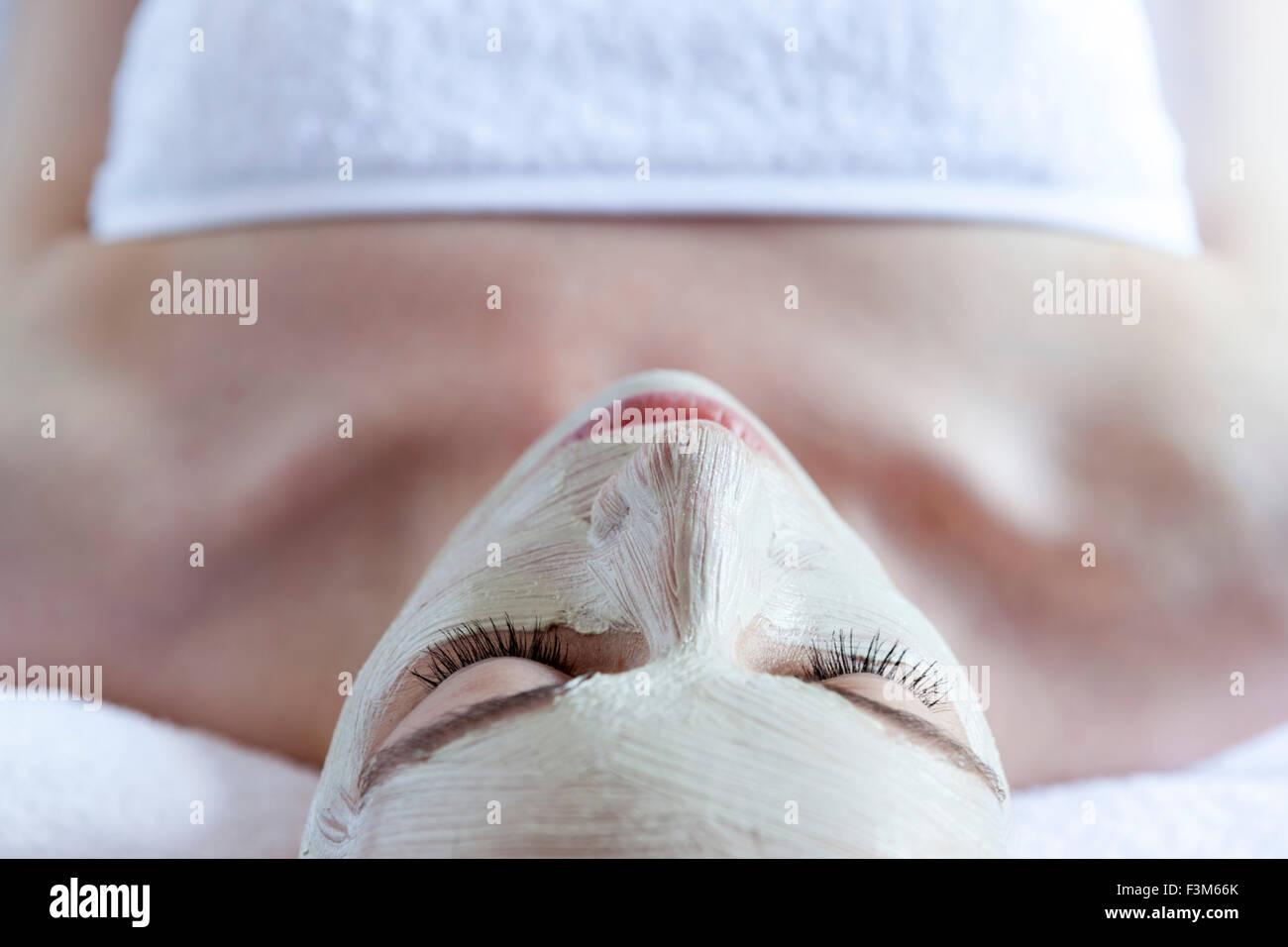 Girl having facial treatment at spa - Stock Image