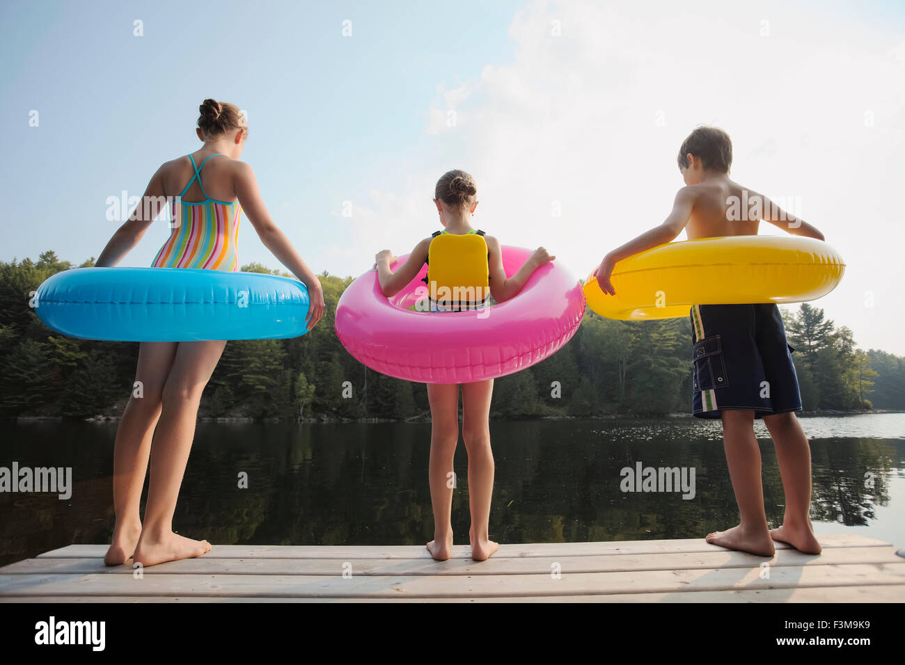 Girl,Jetty,Inflatable,Boy,Lake,Rubber Ring - Stock Image