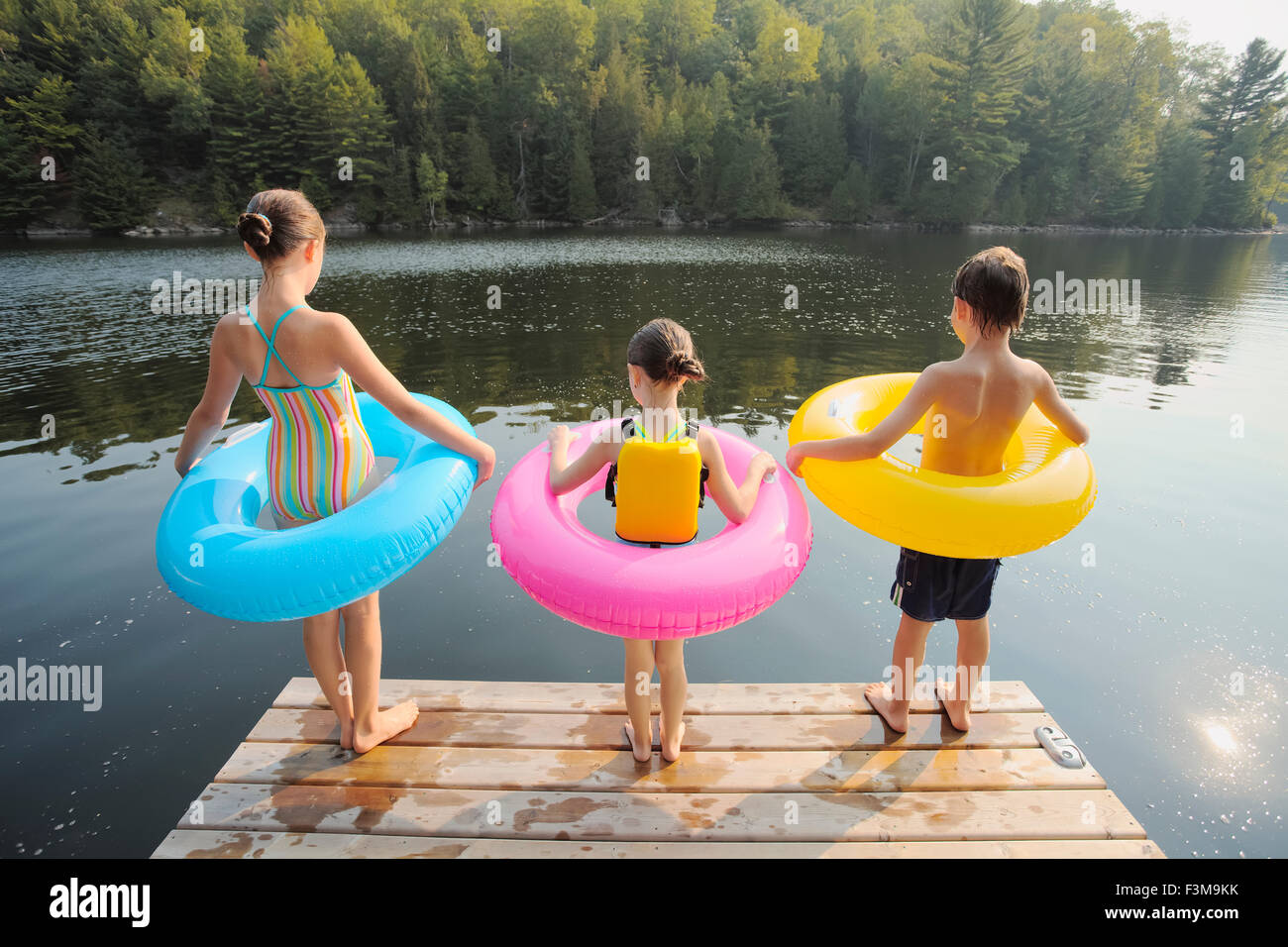Inflatable,Lake,Jetty,Rubber Ring,Girl,Boy Stock Photo