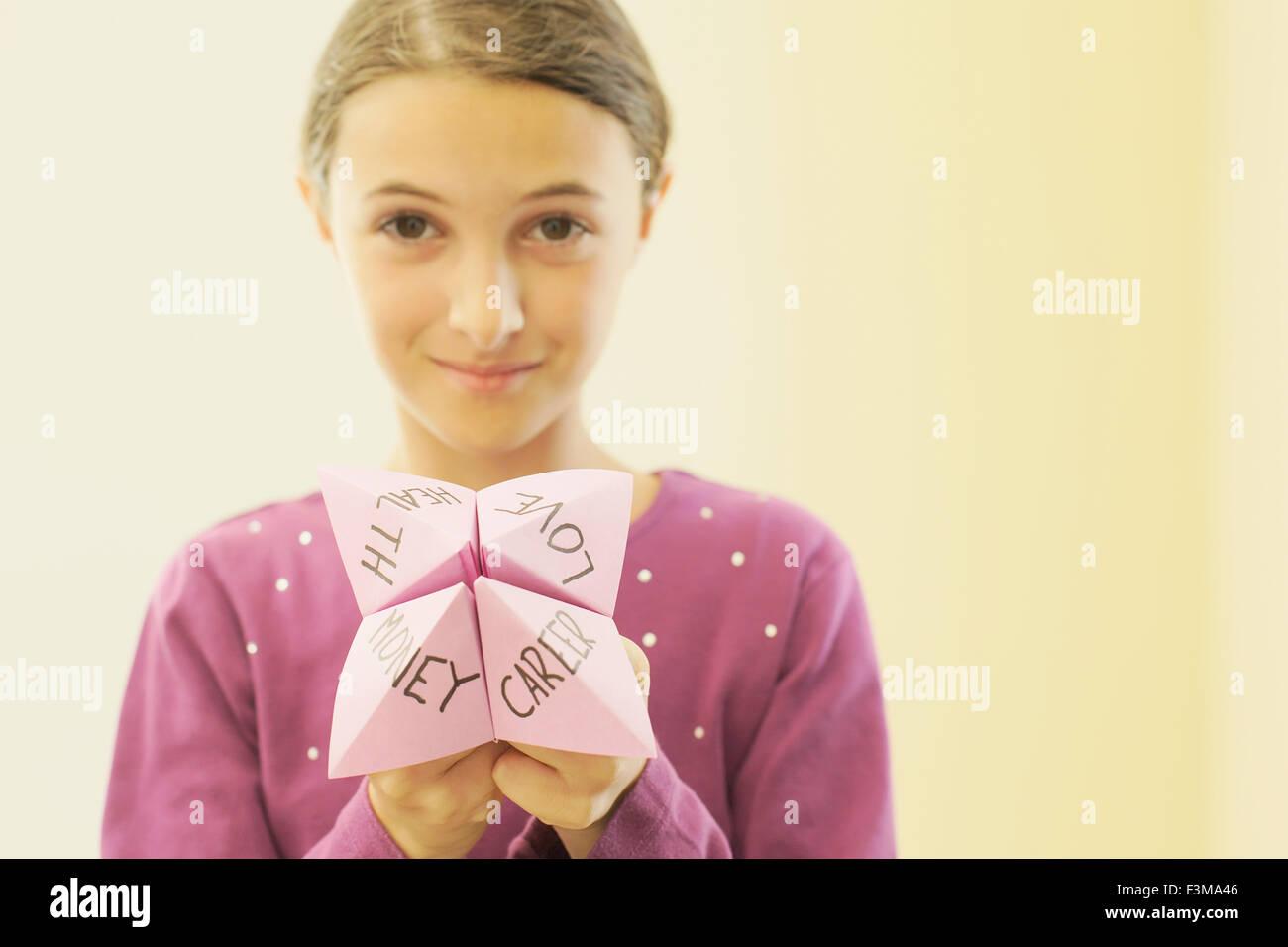 Portrait,Teenage Girl,origami fortune teller - Stock Image