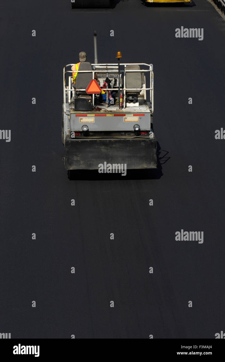 First,Light,1 Person Only,Asphalt,Asphalts,Back - Stock Image