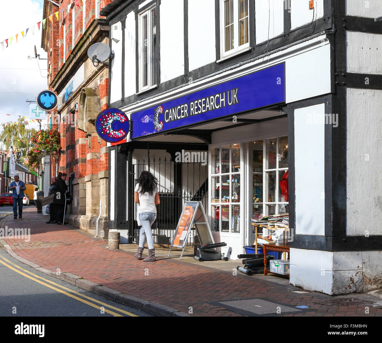 The frontage or facade of a Cancer Research UK shop in Middlewich Cheshire England UK - Stock Image